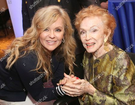 """Jill Whelan, Jeraldine Saunders. Jill Whelan, left, and Jeraldine Saunders attend a gathering after the ceremony honoring Princess Cruises and the original cast of """"The Love Boat"""" with a honorary star plaque at the Hollywood Walk of Fame on in Los Angeles"""