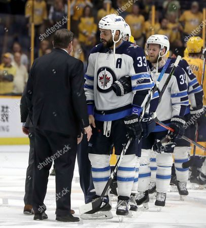 Peter Laviolette, Dustin Byfuglien. Winnipeg Jets defenseman Dustin Byfuglien (33) shakes hands with Nashville Predators coach Peter Laviolette after Game 7 of an NHL hockey second-round playoff series, in Nashville, Tenn. The Jets won 5-1 and advanced to the conference final