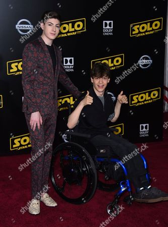"""Mason Cook, Micah Fowler. Mason Cook and Micah Fowler arrive at the premiere of """"Solo: A Star Wars Story"""" at El Capitan Theatre, in Los Angeles"""