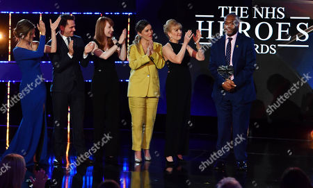 Hero Doctor Award: Martin Griffiths, left, presented by Casualty cast Cathy Shipton, Michael Stevenson, Michelle Fox, Charlotte Salt and Chelsea Halfpenny.