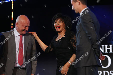 Hero Pioneer Award: Dame Shirley Bassey with award winner surgeon Stephen Large (left) from Papworth Hospital. Steven Tsui and Stephen Large work in Papworth Hospital and will receive the Pioneering Hero award after they made it possible to restart a beating heart allowing a new type of transplant. Their work means more people on the donor register can receive a heart, saving more lives.