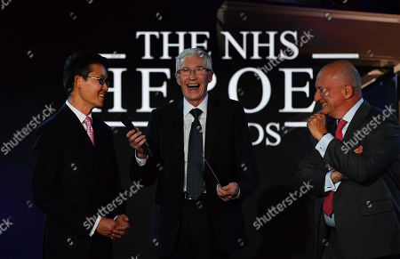 Stock Picture of Hero Pioneer Award: Paul Grady with award winners surgeons Steven Tsui (left) and Stephen Large from Papworth Hospital. They receive the Pioneering Hero award after they made it possible to restart a beating heart allowing a new type of transplant. Their work means more people on the donor register can receive a heart, saving more lives.