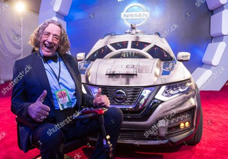 Stock Photo of Peter Mayhew with the Nissan Millennium Falcon Rogue at the 'Solo: A Star Wars Story' film premiere, in Los Angeles