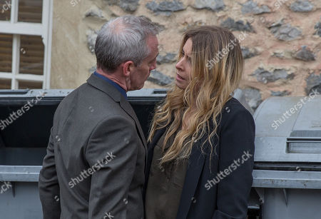Stock Image of Ep 8143 Tuesday 8th May 2018  Bails, as played by Rocky Marshall, emerges as Charity Dingle, as played by Emma Atkins, puts the bins out. He backs her into a corner and Charity struggles to keep it together, lashing out at the bin when he goes.