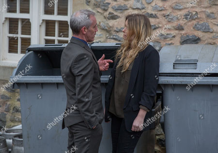Stock Photo of Ep 8143 Tuesday 8th May 2018  Bails, as played by Rocky Marshall, emerges as Charity Dingle, as played by Emma Atkins, puts the bins out. He backs her into a corner and Charity struggles to keep it together, lashing out at the bin when he goes.