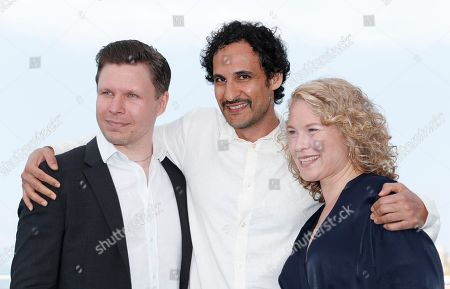 Iranian director Ali Abbasi (C), Swedish actress Eva Melander (R) and Finish actor Eero Milonoff pose during the photocall for 'Grans' at the 71st annual Cannes Film Festival, in Cannes, France, 11 May 2018. The movie is presented in the section Un Certain Regard of the festival which runs from 08 to 19 May.