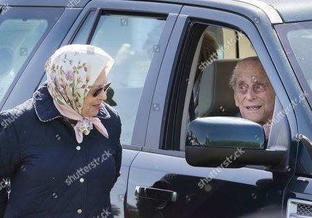 Prince Philip is seen in a car talking to Queen Elizabeth II at the 75th Royal Windsor Horse Show. This is the first time the Duke has been seen since his hip operation last month. The five day event takes place in the grounds of Windsor Castle.