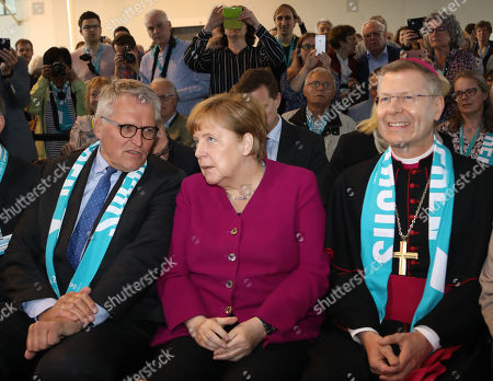 German Chancellor Angela Merkel (C), president of the Central Committee of German Catholics Thomas Sternberg (L) and  Auxiliary Bishop of Muenster Stefan Zekorn (R) attend the 101st German Catholic Convention in Muenster, Germany, 11 May 2018. The convention, which runs from 09 to 13 May, is expected to see the participation of thousands of German Catholics for the so called 'Katholikentag' in the Westphalian city.