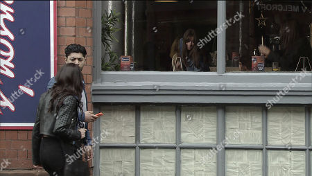 Stock Picture of Ep 9459 Friday 18 May 2018 - 1st Ep Having clocked Kate Connor, as played by Faye Brookes, and Sophie Webster, as played by Brooke Vincent, heading to town, Zeedan Nazir, as played by Qasim Akhtar, follows them, convinced they're seeing each other. Arriving at the pub Rana Nazir's, as played by Bhavna Limbachia, horrified to see Zeedan taking photos of Kate and Sophie through the window. When he admits he thought they were having an affair and was hoping to present her with the proof how will Rana react?
