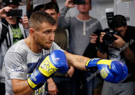 WBO super featherweight champion Vasyl Lomachenko, of Ukraine, punches a bag during a workout at a Manhattan boxing gym in New York. Lomachenko will fight Jorge Linares, for Linares' WBA lightweight championship in New York