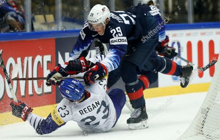 Tage Thompson, right, of the United States checks South Korea's Eric Regan, left, during the Ice Hockey World Championships group B match between united States and South Korea at the Jyske Bank Boxen arena in Herning, Denmark