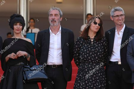 Mitra Farahani, Jean-Paul Battagia, Nicole Brenez. Producers Mitra Farahani, from left, Jean-Paul Battagia, Nicole Brenez director of photography Fabrice Aragno pose for photographers upon arrival of the film 'The Image Book' at the 71st international film festival, Cannes, southern France