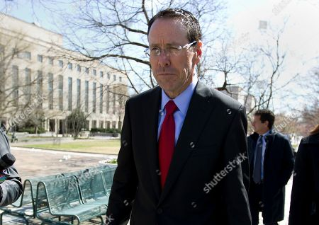 """AT&T CEO Randall Stephenson leaves the federal courthouse in Washington. Stephenson says the company made a """"big mistake"""" in hiring President Donald Trump's attorney Michael Cohen as a political consultant. In an internal memo to employees, obtained by The Associated Press, Friday, May 11, Stephenson called the hiring a """"serious misjudgment,'"""" and said that the company's chief lobbyist in Washington is leaving"""