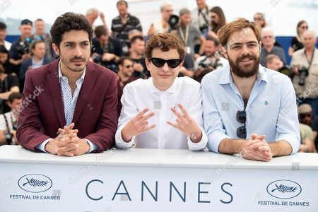 Actor Lorenzo Ferro (C) makes a hand gesture as he poses with actors Juan Lanzani (R) and Chino Darin (L)