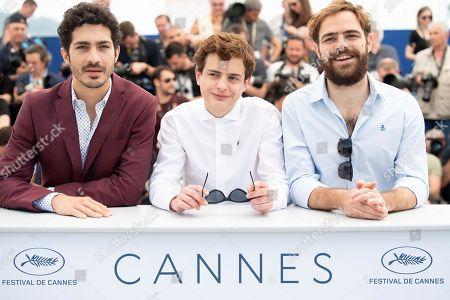Actor Lorenzo Ferro (C) poses with actors Juan Lanzani (R) and Chino Darin (L)