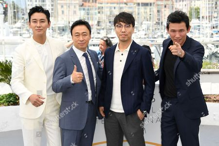 Ju Ji-Hoon, Lee Sung-Min, Yoon Jong-Bin, Hwang Jung-Min. Actor Ju Ji-Hoon, from left, actor Lee Sung-Min, director Yoon Jong-Bin and Hwang Jung-Min pose for photographers during a photo call for the film 'Gongjak' at the 71st international film festival, Cannes, southern France