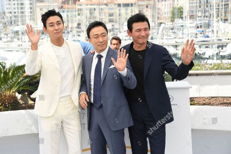 Ju Ji-Hoon, Lee Sung-Min, Hwang Jung-Min. Actors Ju Ji-Hoon, from left, Lee Sung-Min and Hwang Jung-Min pose for photographers during a photo call for the film 'Gongjak' at the 71st international film festival, Cannes, southern France