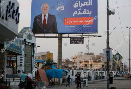 Campaign poster of Iraqi Prime Minister Haider al-Abadi in seen in Baghdad, Iraq. Four years in office, Iraqi Prime Minister Haidar al-Abadi has racked up a list of achievements to make most politicians green with envy. He prevailed over an Islamic State insurgency that at its peak controlled one-third of the country. He steered Iraq's economy through a collapse in global oil prices. And he foiled a Kurdish bid for independence
