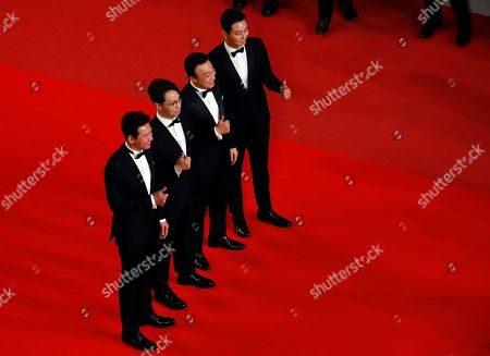 (L-R)  South Korean actor Ju Ji-Hoon, South Korean director Yoon Jong-Bin, South Korean actor Lee Sung-Min and South Korean actor Ju Ji-Hoon arrives for the screening of 'The Spy Gone North (Gongjak)' during the 71st annual Cannes Film Festival, in Cannes, France, 11 May 2018. The movie is presented in the section Midnight Screenings at the festival which runs from 08 to 19 May.