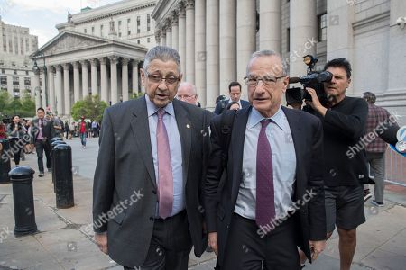 Former New York Assembly Speaker Sheldon Silver, left, leaves federal court, in New York. A jury convicted Silver of public corruption charges Friday, dashing the 74-year-old Democrat's second attempt to avoid years in prison after a decades-long career as one of the most powerful politicians in state government