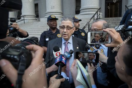 Former New York Assembly Speaker Sheldon Silver speaks to reporters outside federal court, in New York. A jury convicted Silver of public corruption charges Friday, dashing the 74-year-old Democrat's second attempt to avoid years in prison after a decades-long career as one of the most powerful politicians in state government