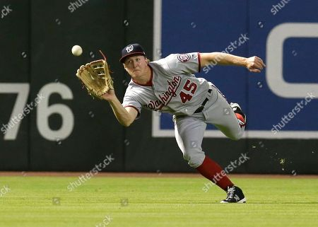 Stock Image of Washington Nationals left fielder Andrew Stevenson makes the running catch on a ball hit by Arizona Diamondbacks' Nick Ahmed during the fifth inning og a baseball game, in Phoenix
