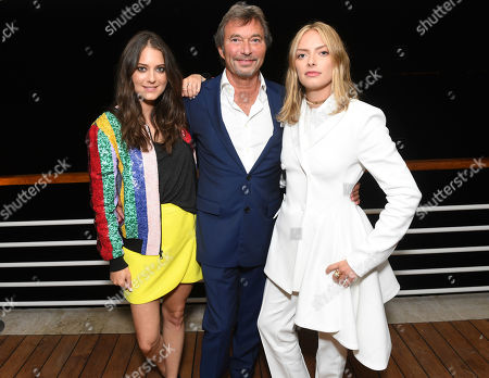 Stock Image of Justine Wachsberger, Patrick Wachsberger, Olivia Wachsberger. From left, Justine Wachsberger, Patrick Wachsberger, Co-Chairman of Lionsgate Motion Picture Group, and Olivia Wachsberger at the Lionsgate Cannes Party at the Hotel du Cap-Eden-Roc, in Cannes, France