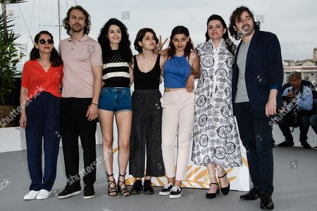 (R-L) Actors Metin Akdulger and Saad Lostan, director Gaya Jiji and actresses Manal Issa, Nathalie Issa, Mariah Tannoury and Souraya Baghdadi poseduring the photocall for 'My Favorite Fabric (Mon Tissu Prefere)' at the 71st annual Cannes Film Festival, in Cannes, France, 12 May 2018. The movie is presented in the section Un Certain Regard of the festival which runs from 08 to 19 May.