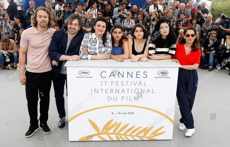 (L-R) Actors Metin Akdulger and Saad Lostan, director Gaya Jiji and actresses Manal Issa, Nathalie Issa, Mariah Tannoury and Souraya Baghdadi pose during the photocall for 'My Favorite Fabric (Mon Tissu Prefere)' at the 71st annual Cannes Film Festival, in Cannes, France, 12 May 2018. The movie is presented in the section Un Certain Regard of the festival which runs from 08 to 19 May.