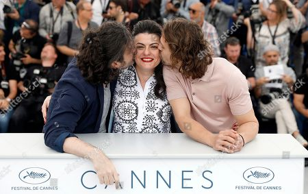 Actors Metin Akdulger (R) and Saad Lostan and director Gaya Jiji pose during the photocall for 'My Favorite Fabric (Mon Tissu Prefere)' at the 71st annual Cannes Film Festival, in Cannes, France, 12 May 2018. The movie is presented in the section Un Certain Regard of the festival which runs from 08 to 19 May.