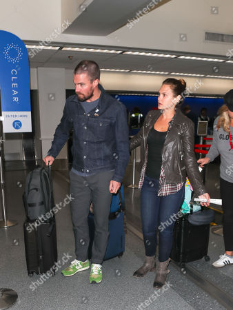 Stock Picture of Stephen Amell and Cassandra Jean