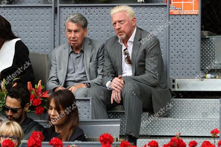 Stock Image of Tennis legends Manolo Santana (CL) from Spain, and German Boris becker (CR), during the Mutua Madrid Open Men's semifinals match played against South African tennis player Kevin Anderson and Austrian Dominic Thiem at Caja Magica in Madrid, Spain, 12 May 2018.