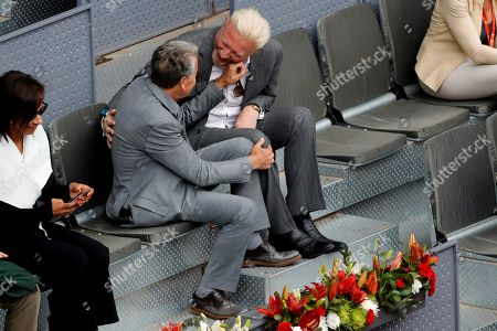 Stock Photo of Tennis legends Manolo Santana (CL) from Spain, and German Boris Becker (CR), during the Mutua Madrid Open Men's semifinals match played against South African tennis player Kevin Anderson and Austrian Dominic Thiem at Caja Magica in Madrid, Spain, 12 May 2018.