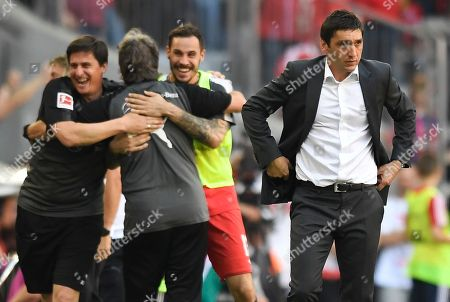 Stuttgart's head coach Tayfun Korkut (R) reacts during the German Bundesliga soccer match between Bayern Munich and VfB Stuttgart in Munich, Germany, 12 May 2018.