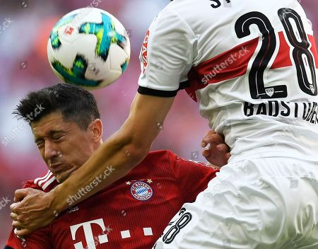 Bayern's Robert Lewandowski (L) in action against Stuttgart's Holger Badstuber during the German Bundesliga soccer match between Bayern Munich and VfB Stuttgart in Munich, Germany, 12 May 2018.
