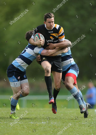 Stock Picture of Matthew Jarvis of Merthyr takes on Julian Mogg of Bargoed and Duane Dyer of Bargoed