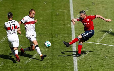 Stuttgart's Holger Badstuber blocks a shot by Bayern's Robert Lewandowski, right, during the German Soccer Bundesliga match between FC Bayern Munich and VfB Stuttgart in Munich, Germany