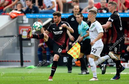 Leverkusen's scorer Lucas Nicolas Alario, left, wins the ball against Hannover's Matthias Ostrzolek during the German Bundesliga soccer match between Bayer Leverkusen and Hannover 96 in Leverkusen, Germany