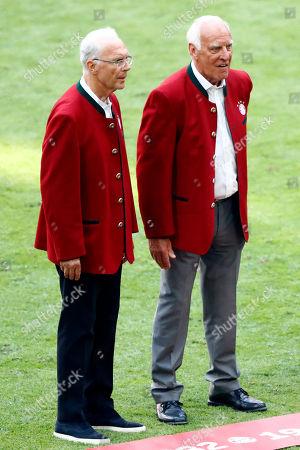 Bayern legends Franz Beckenbauer, left, and Franz Roth attend the German Soccer Bundesliga match between FC Bayern Munich and VfB Stuttgart in Munich, Germany