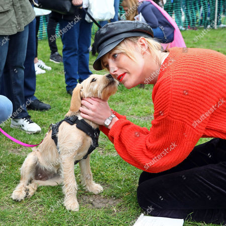 Stock Photo of Judge Aisling Jarrett-Gavin with Ruby the Miniature Labradoodle at the All Dogs Matter Great Hampstead Bark Off, Hampstead Heat, London. All Dogs Matter is a charity dedicated to helping and re-homing dogs see www.alldogsmatter.co.uk for more information.