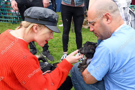 Stock Image of Judges Aisling Jarrett-Gavin and Marc Abraham with Marlow the Yorkiepoo at the All Dogs Matter Great Hampstead Bark Off, Hampstead Heat, London. All Dogs Matter is a charity dedicated to helping and re-homing dogs see www.alldogsmatter.co.uk for more information.