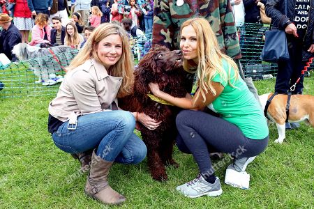 Stock Image of Judges Anneka Svenska and Pip Tomson with Finn McCool the Irish Water Spaniel at the All Dogs Matter Great Hampstead Bark Off, Hampstead Heat, London. All Dogs Matter is a charity dedicated to helping and re-homing dogs see www.alldogsmatter.co.uk for more information.