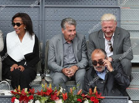 Stock Picture of Tennis Legends Boris Becker  and Manolo Santana share a  joke with Ion Tiriac as they watch  Dominic Thiem from Austria beat Kevin Anderson from South Africa in Semi Final