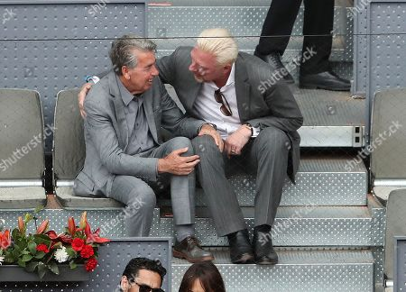Tennis Legends Boris Becker  and Manolo Santana share a  joke  as they watch  Dominic Thiem from Austria beat Kevin Anderson from South Africa in Semi Final