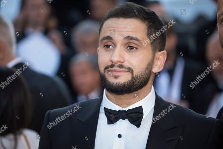 Malik Bentalha poses for photographers upon arrival at the premiere of the film 'Girls of The Sun' at the 71st international film festival, Cannes, southern France