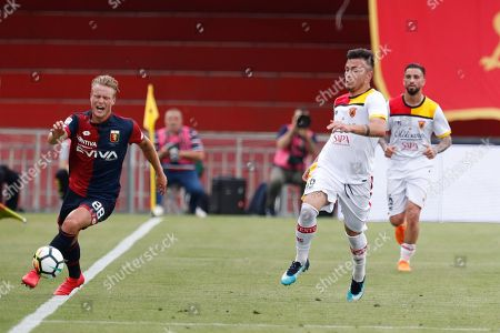 Genoa CFC's Oscar Hiljemark and Benevento Calcio's Alin Dorinel Tosca in action during the Italian Serie A soccer match between Benevento Calcio and Genoa CFC at Ciro Vigorito stadium in Benevento, Italy, 12 May 2018.
