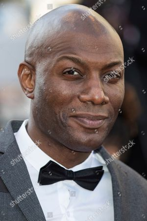 Harry Roselmack poses for photographers upon arrival at the premiere of the film 'Girls of The Sun' at the 71st international film festival, Cannes, southern France