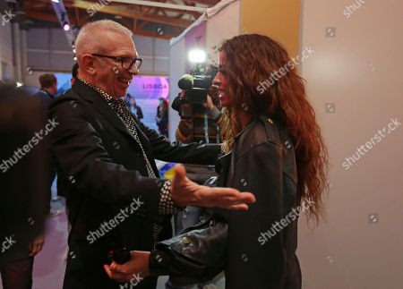 Contestant Eleni Foureira from Cyprus speaks backstage to French fashion designer Jean-Paul Gauthier in Lisbon, Portugal, before the Eurovision Song Contest grand final