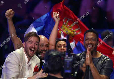 Cesar Sampson from Austria, right, reacts as votes are announced during the Eurovision Song Contest grand final in Lisbon, Portugal
