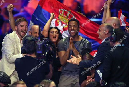 Cesar Sampson from Austria, third right, reacts as votes are announced during the Eurovision Song Contest grand final in Lisbon, Portugal